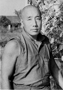 An early portrait of His Holiness taken in India, sleeves rolled up, working hard to re-establish the monastery.